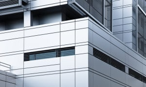 Building with bespoke panels